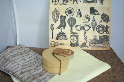 a photo of a cardboard trinket box, some decoupage paper, some tissue paper a couple of cardboard cogs and a small length of chain,