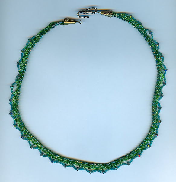 Green lace constructed with seed beads