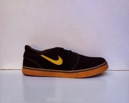 Sepatu Nike Stefan Janoski hitam kuning