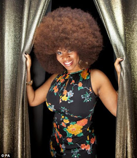 Aevin Dugas has World's Largest Afro
