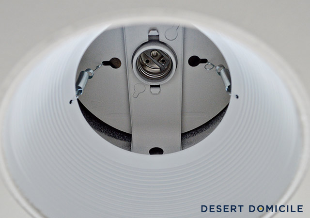 If your recessed light is like ours it will have two mounting springs holding it up. & How to Turn a Recessed Light into a Hardwired Light | Desert Domicile azcodes.com