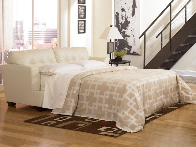 calm brown comfortable sleeper sofa with wooden flooring