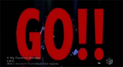 """GO!!"" in large red letters over Maya and Aiji raving."