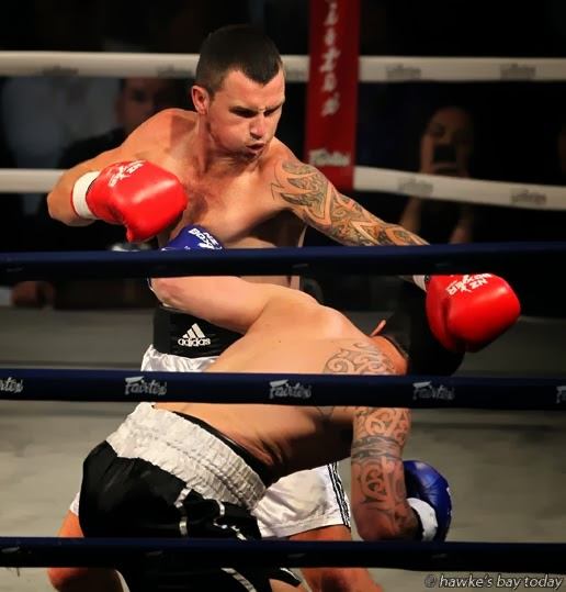 Beau O'Brien from Napier (red gloves) beat Daniel Maxwell from Christchurch, in a New Zealand Professional light middleweight NZPBA title contest, at the Pettigrew.Green Arena, Taradale, Napier. photograph