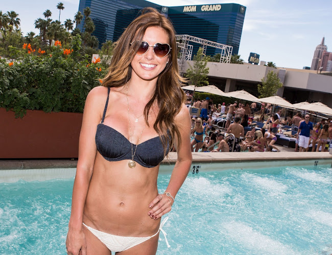 Audrina Patridge posing wearing a bikini in the pool at Wet Republic