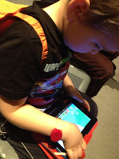 Big Boy playing Minecraft on his Tablet