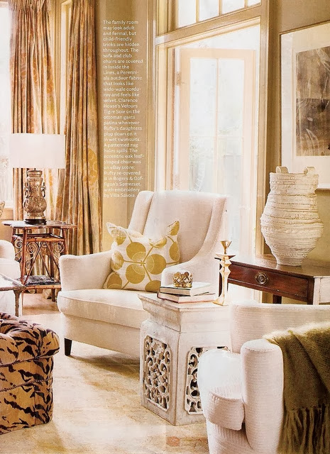 white living room with gold accents beige neutral furniture