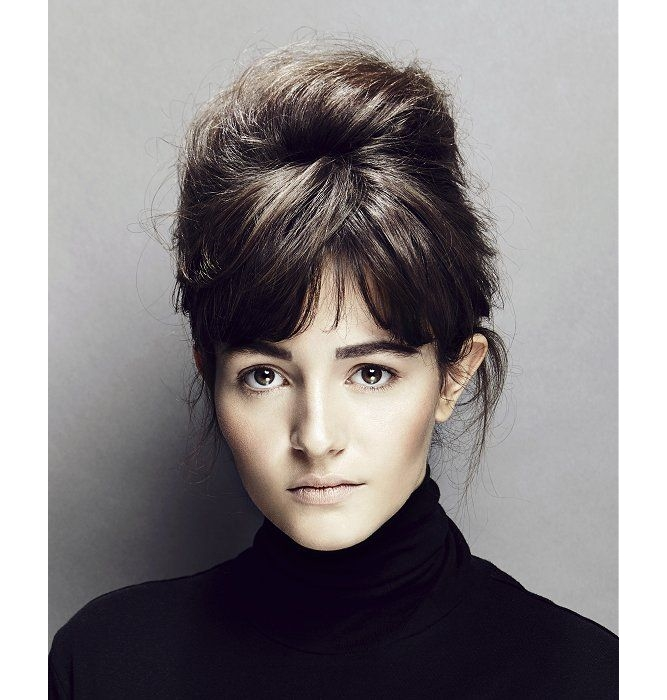 sixties hairstyle - bun updo with bangs