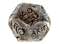 Photograph of an ancient twelve-sided die marked with the twelve signs of the zodiac in Latin.