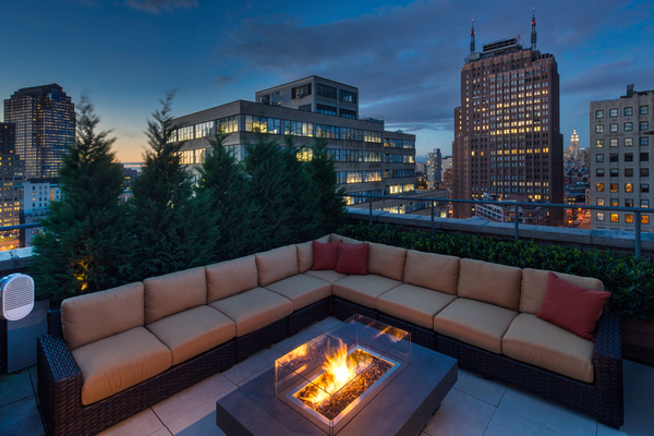 Photo of large outdoor sofa and fireplace on the terrace of 66 Leonard Street penthouse