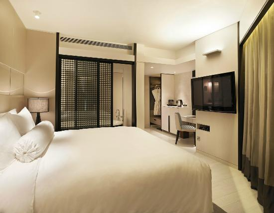 naumi hotel boutique singapore oasis habitat patio room bedroom suite