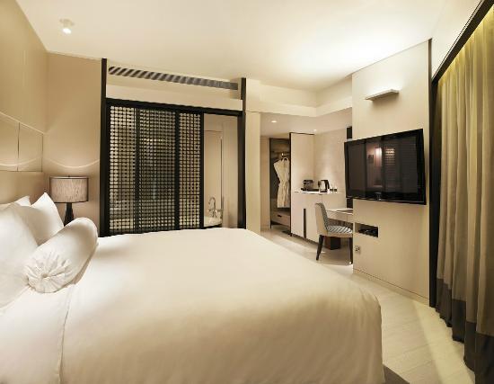 naumi hotel boutique singapore oasis habitat patio room bedroom suite