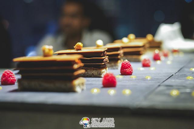 Beautiful desserts for a good ending of dinner in the sky 'Valrhona' Jivara Grand Cru Chocolate Praline, Creme Chantilly Crunchy Hazelnut with Exotic Gel