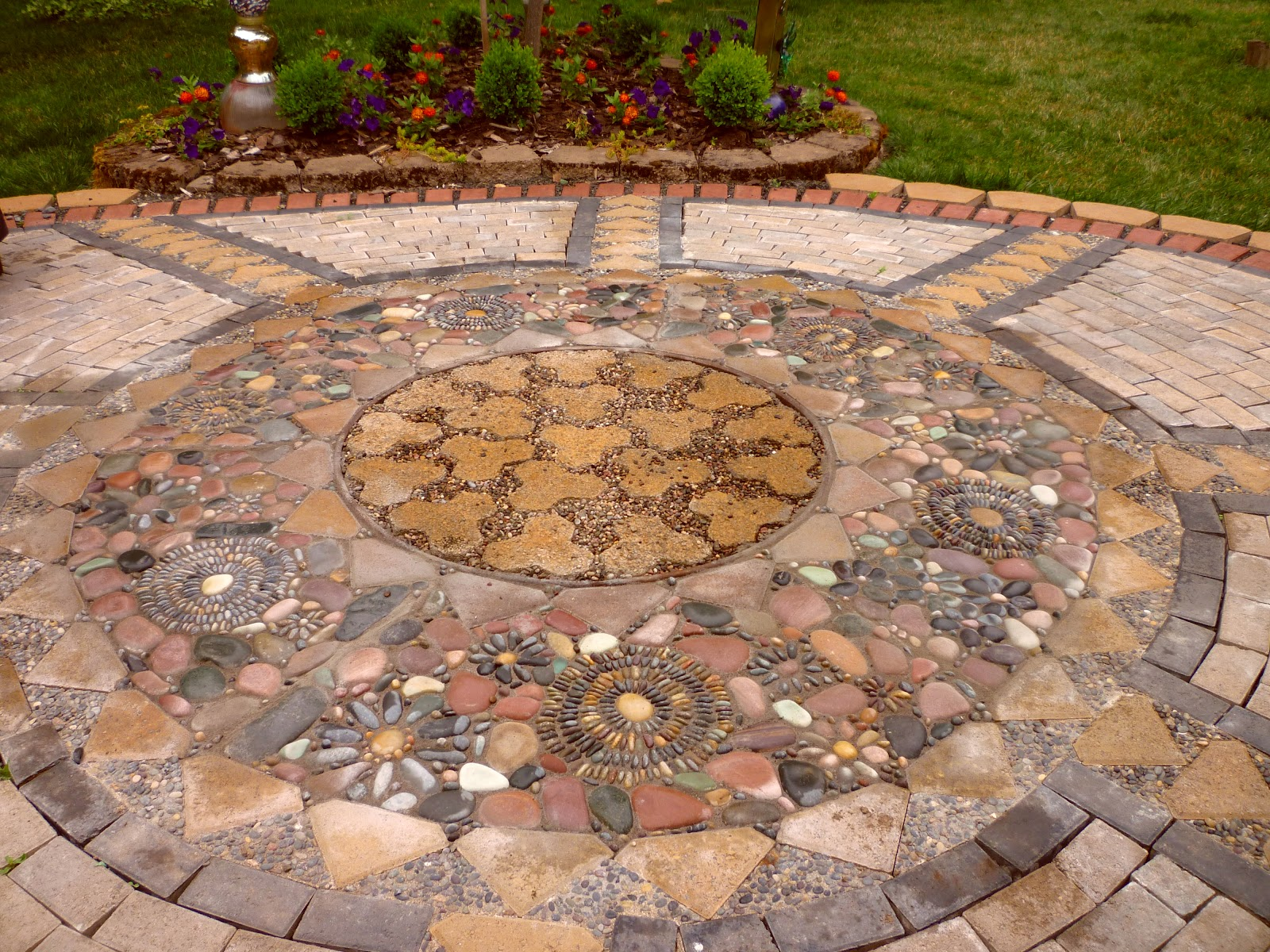 Wow thats a busy garden creating a paver and pebble mosaic patio - Basics mosaic tiles patios ...