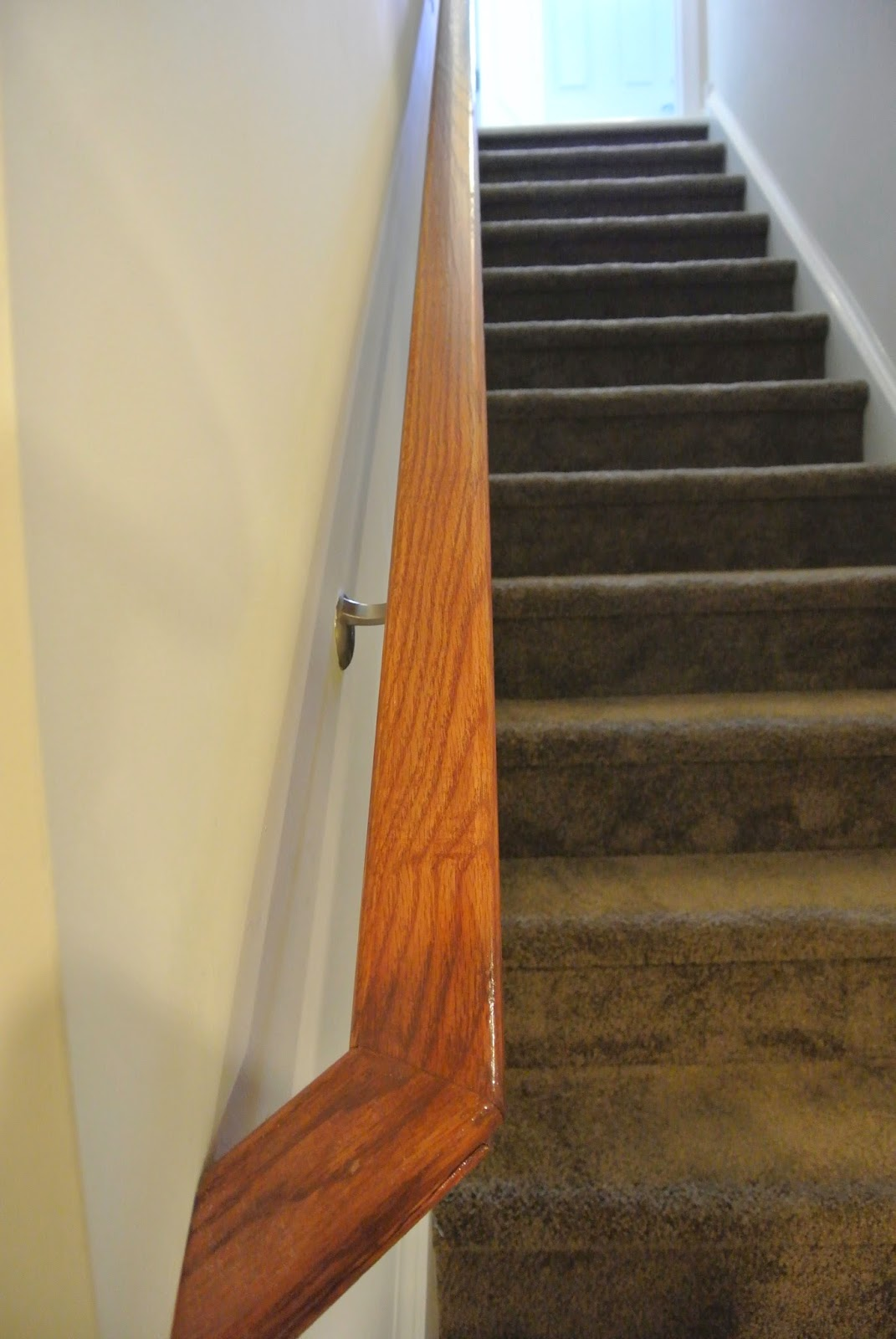 A picture of the finished railing on the basement stairs.