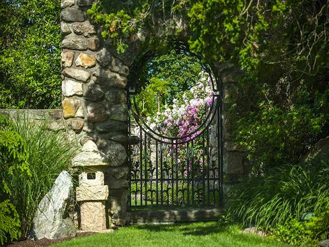 Stone wall iron garden gate at Copper Beech Farm