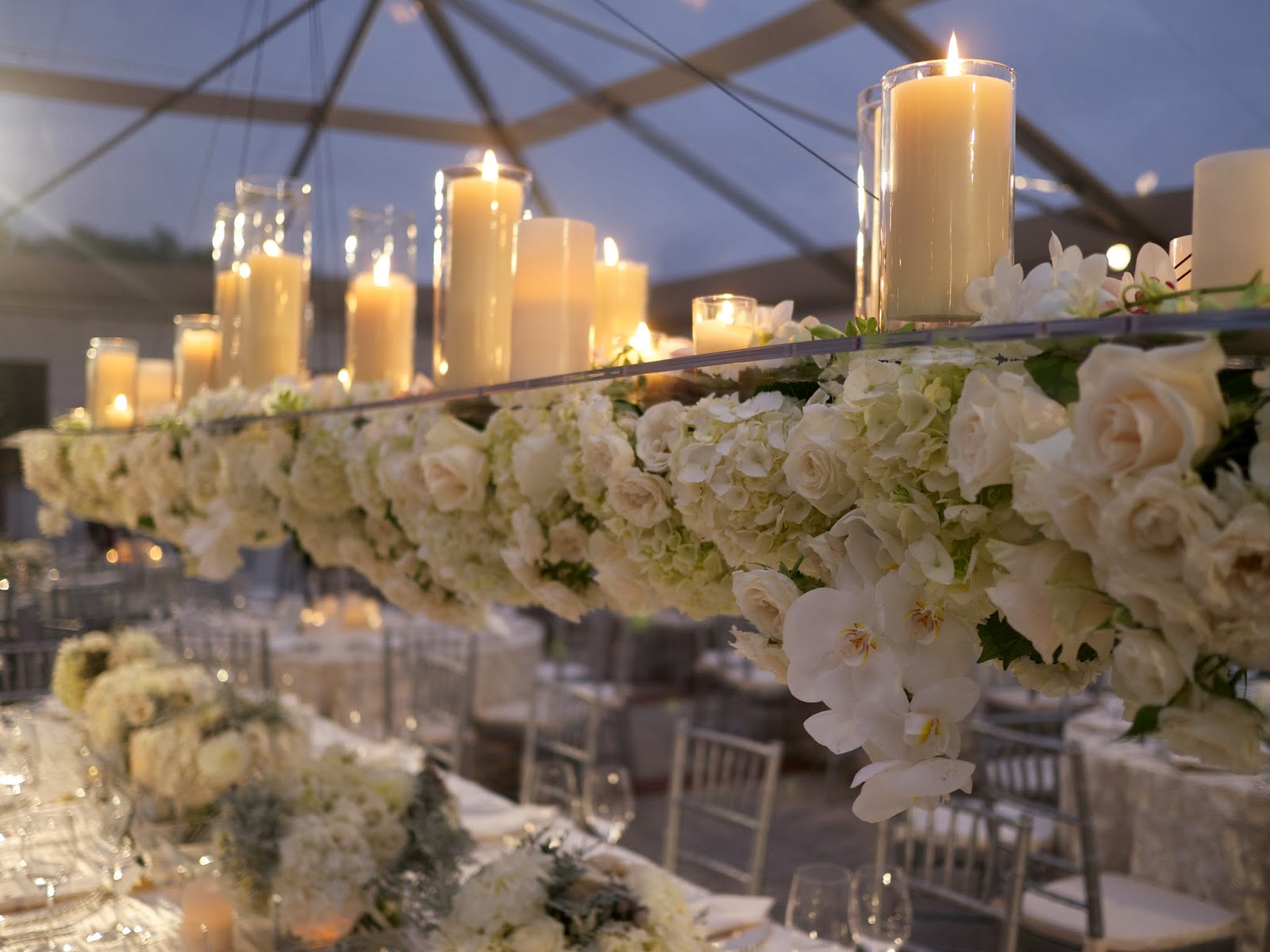 Suspended florals for weddings suspended floral arrangements - Long Suspended Chandelier Above The Head Table