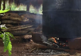 Heating Waragi, also known as Kasese or Lira Lira  homemade distilled gin.