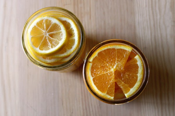 Jars of preserved lemons and oranges