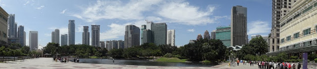 A panaromic view of the lake recreation area which is surrounded by skyscrapers at Suria KLCC shopping mall in Kuala Lumpur, Malaysia