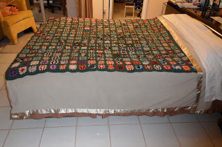 Quilt shown covering a queen-sized bed.