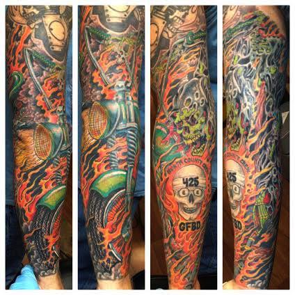 Biker sleeve tattoo of grim reaper, flames, and skull by tattoo artist Jason Kunz for Triumph Tattoo