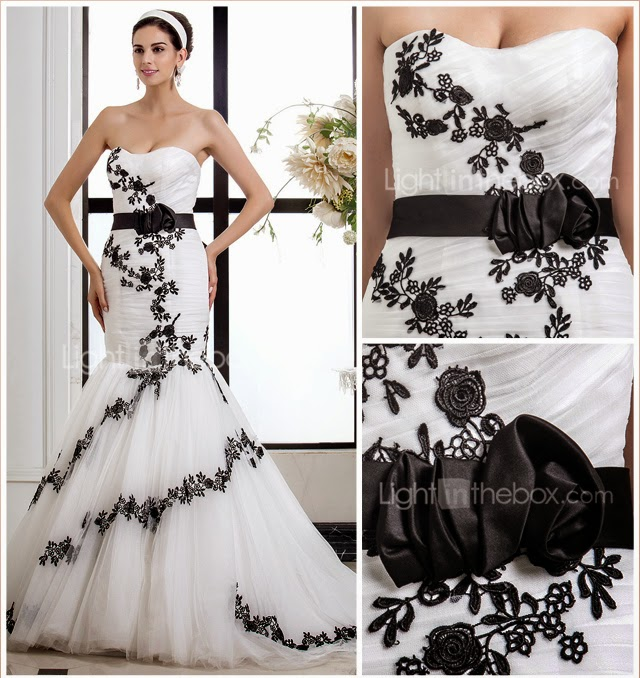 queusar: vestido de novia sirena con cinturon y flores negras