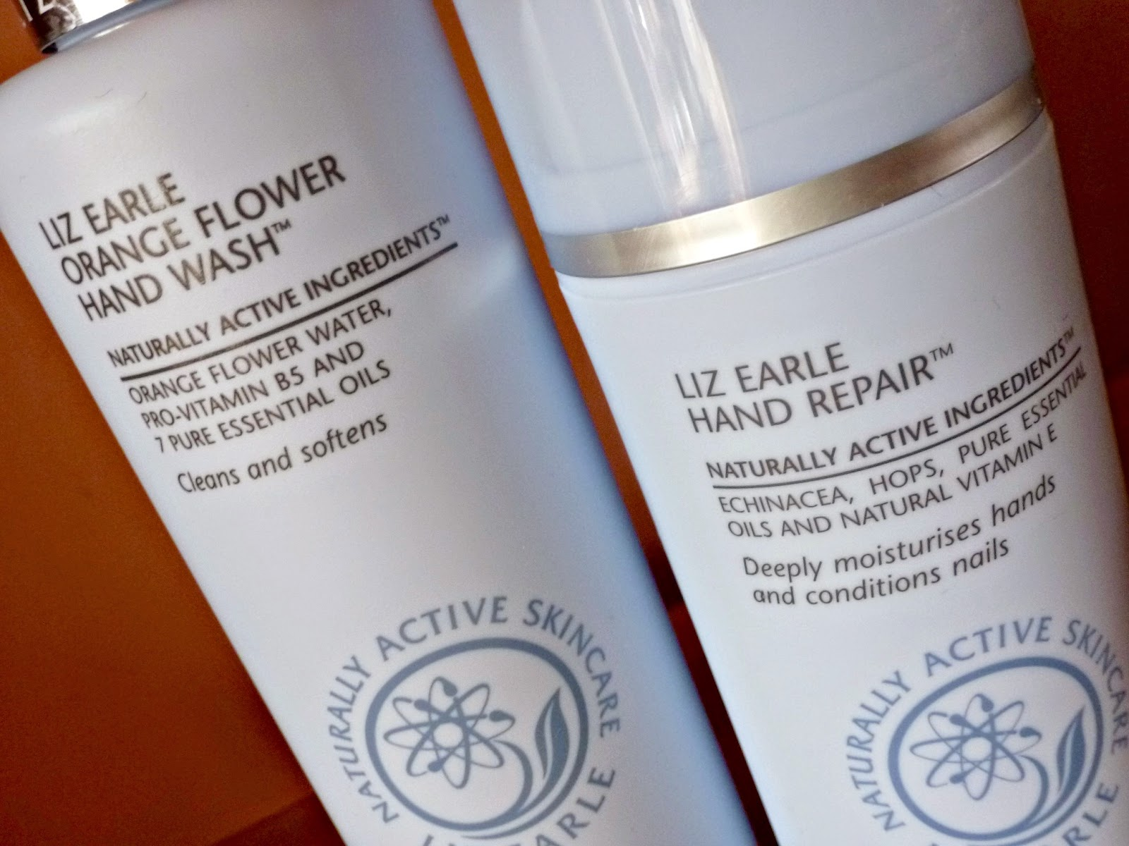 A picture of Liz Earle Orange Flower Hand Wash and  Liz Earle Hand Repair