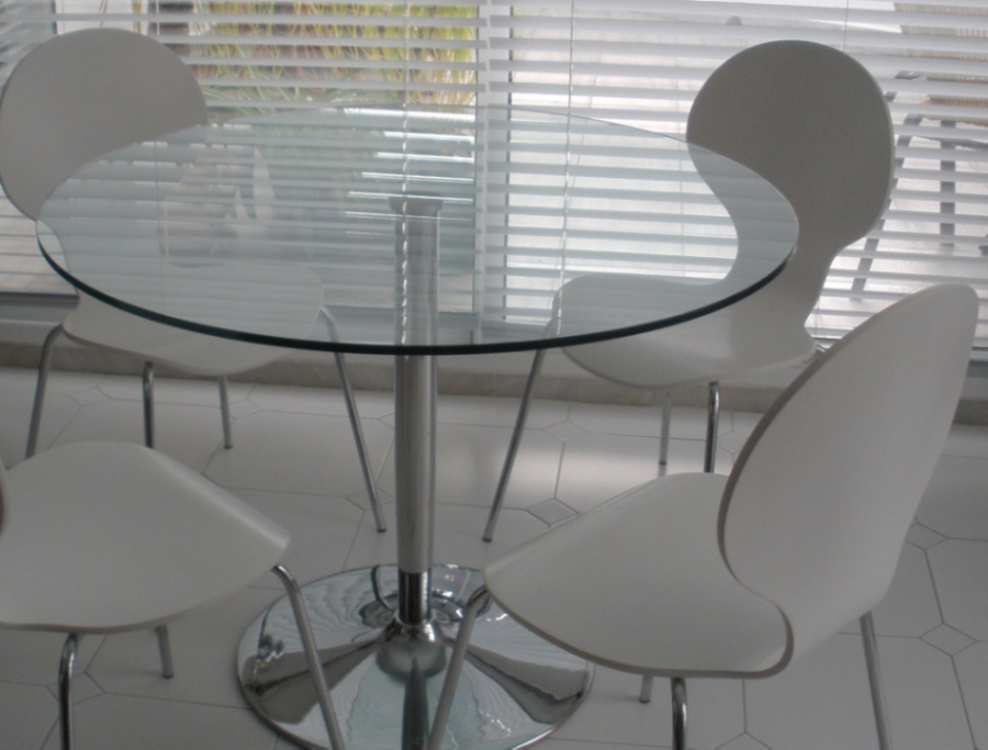 Glass And Chrome Dining Table And Four White Chairs For Sale