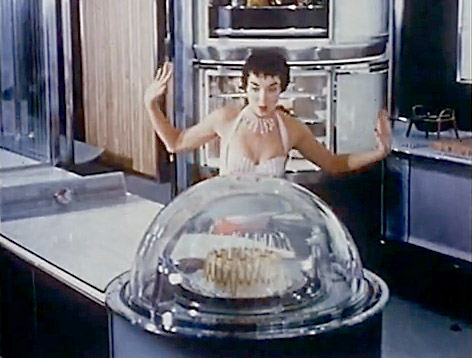 Design for Dremaing, kitchen of the future bakes a cake in a glass dome.