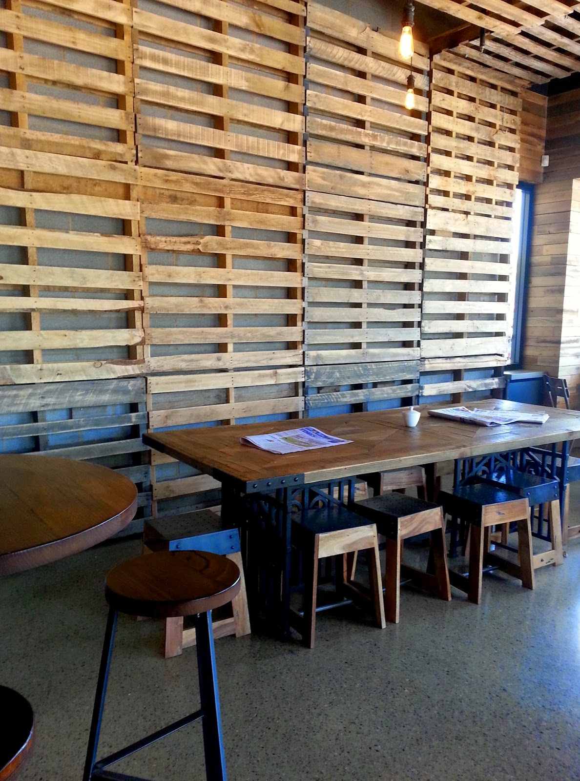 Interior of Coffee Lab cafe, with walls lined with pallets.
