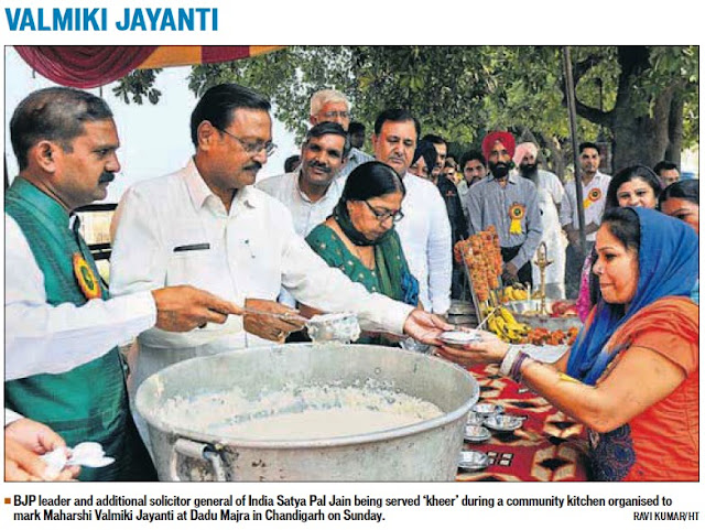 Valmiki Jayanti: BJP leader & Additional Solicitor General of India Satya Pal Jain being served 'Kheer' during a community kitchen organised to mark Maharshi Valmiki Jayanti at Dadu Majra in Chandigarh