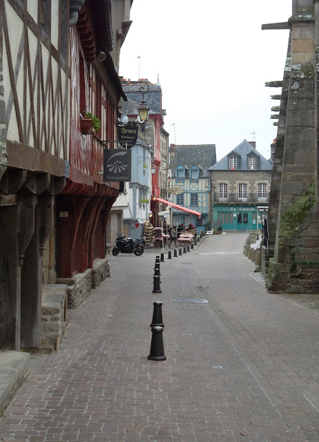 Medieval streets of Josselin. Half timbered buildings and cobbled streets.