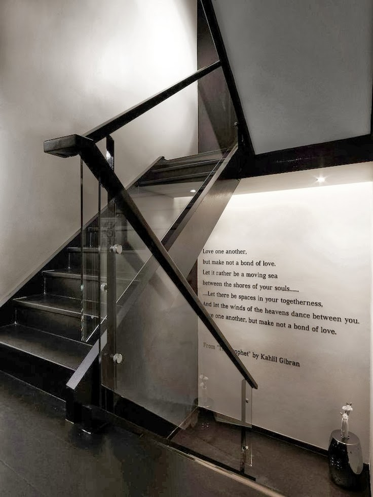 metal stairs with glass handrails