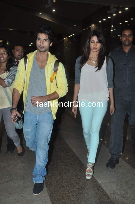 Priyanka is wearing some baby blue colored jeans and a casual top. Shahid also chooses casual denim and a yellow hoodie.  -  Shahid & Priyanka arriving to watch Teri Meri Kahani @ ketnav