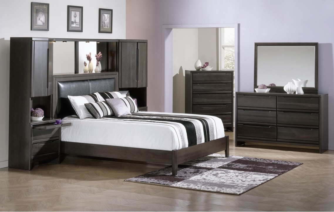 Large bedroom with gray sheets
