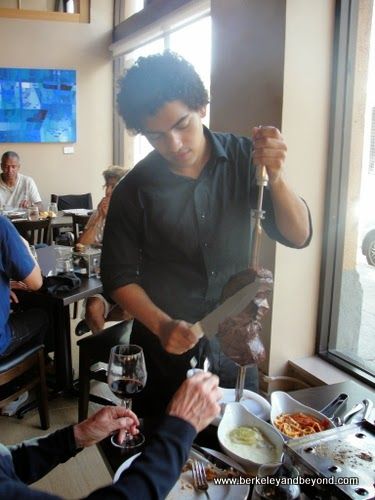 skewered meat service at Galeto Brazilian Grill in Oakland, California