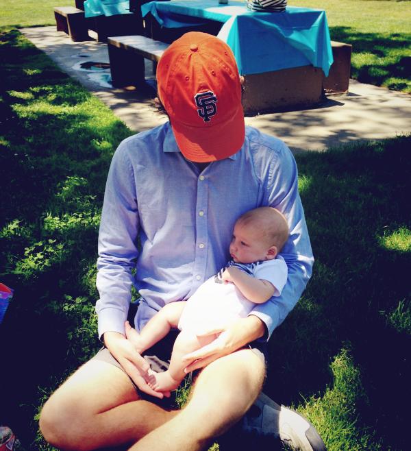 men holding babies