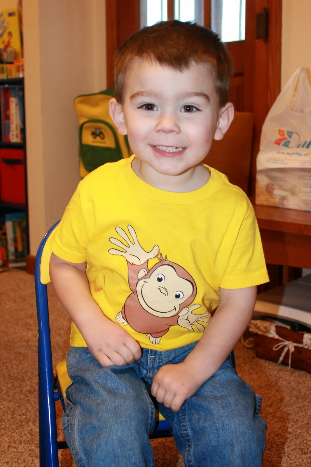 Excited Birthday Boy in his Curious George shirt