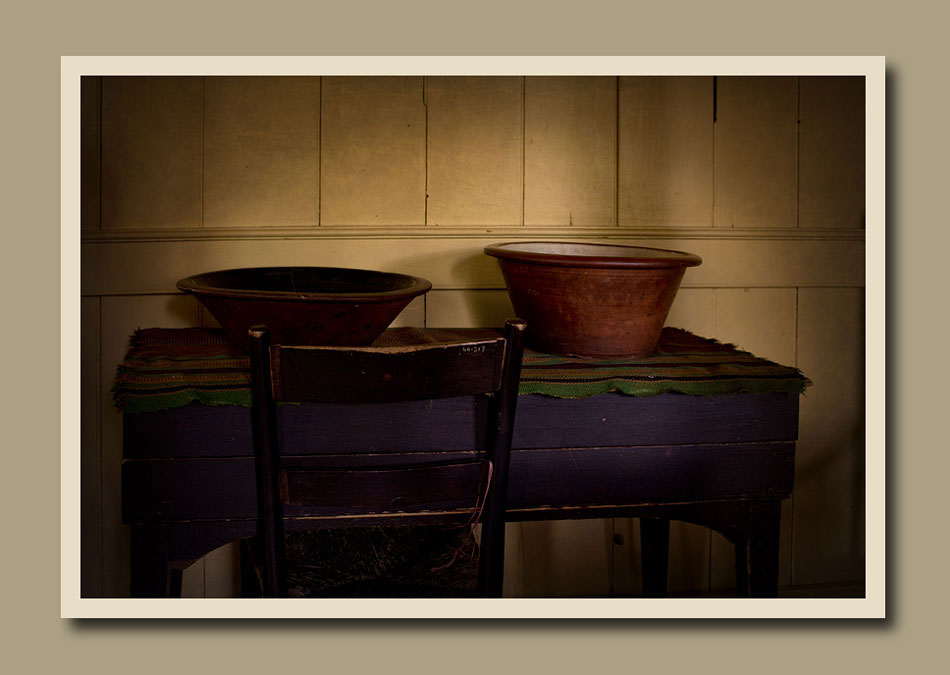 A wood carved bowl and a pottery bowl on a very old table at Black Creek Pioneer Village.  Holly Cawfield Photography