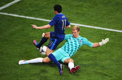 England goalkeeper Joe Hart tries to tackle France midfielder Samir Nasri