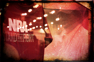 T-shirt on display reads 'NRA -Stand and Fight'