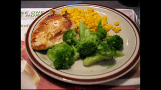Grilled chicken with corn and broccoli.