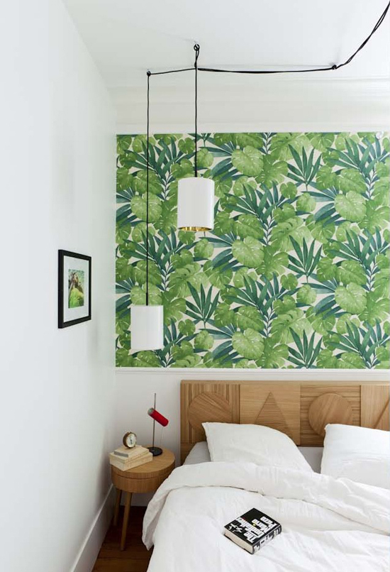 Fresh bedroom with a green tropical wallpaper