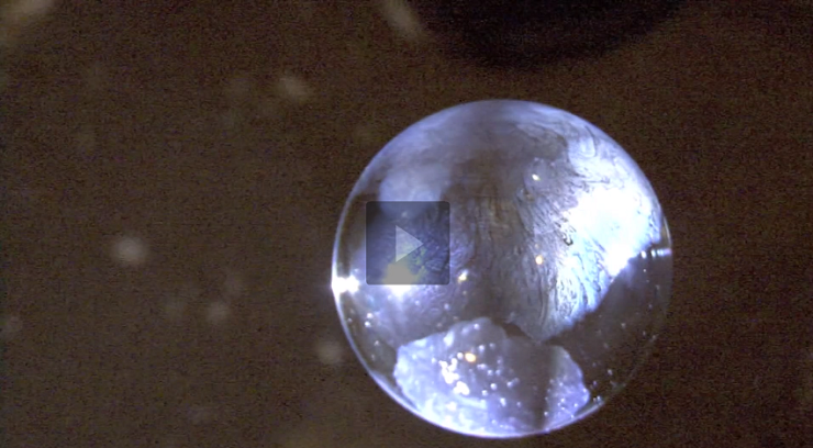Water Create Bubbles And Freezing In Mid-Air