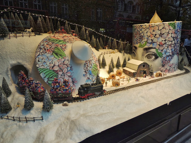 Fornasetti candle in festive window of Selfridges
