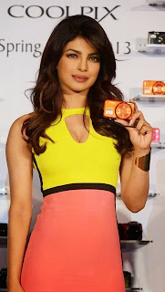 Priyanka Chopra in Bright Yellow Pink Dress at Camera Launch Event