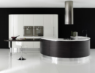 wall oven in contemporary curved kitchen in black and white