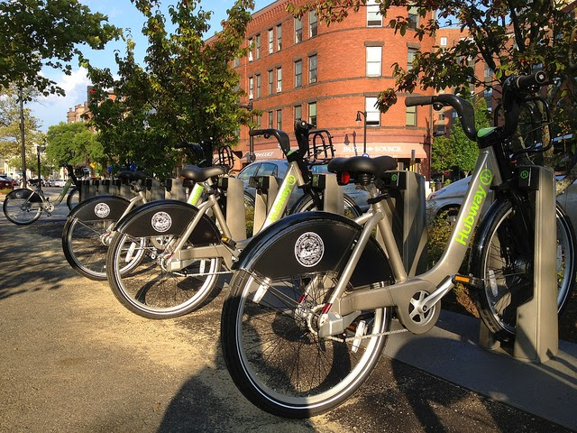 Bike-share bikes lined up at a bicycle rack