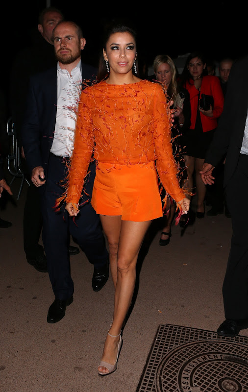 Eva Longoria leggy in orange outfit